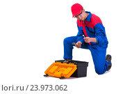 Купить «Young repairman with wrench spanner isolated on white», фото № 23973062, снято 2 мая 2016 г. (c) Elnur / Фотобанк Лори