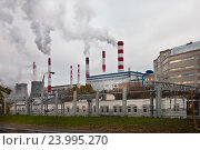 Купить «Дымящие трубы теплоэлектростанции в городе», фото № 23995270, снято 28 октября 2016 г. (c) Victoria Demidova / Фотобанк Лори
