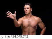 Купить «Ripped muscular man pressing virtual buttons», фото № 24045742, снято 27 августа 2016 г. (c) Elnur / Фотобанк Лори