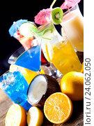 Купить «Alcohol drinks, beach background, natural colorful tone», фото № 24062050, снято 10 июня 2014 г. (c) easy Fotostock / Фотобанк Лори
