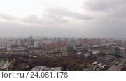 Купить «Panoramic aerial view of one of the districts of Moscow with road traffic, cloudy weather. Urban cityscape», видеоролик № 24081178, снято 22 сентября 2016 г. (c) Данил Руденко / Фотобанк Лори