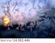 Купить «Морозный узор и солнце на зимнем окне, вечер, закат», фото № 24082446, снято 24 января 2016 г. (c) ElenArt / Фотобанк Лори