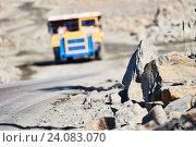 Купить «Huge dump truck transporting granite rock or iron ore», фото № 24083070, снято 8 сентября 2016 г. (c) Дмитрий Калиновский / Фотобанк Лори