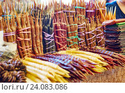 Купить «Churchkhela. Traditional Georgian candy with nut», фото № 24083086, снято 17 сентября 2015 г. (c) Дмитрий Калиновский / Фотобанк Лори