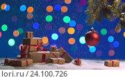 Купить «Christmas ball and a fir branch with gift box on a wooden background with snowing», видеоролик № 24100726, снято 30 октября 2016 г. (c) Анатолий Типляшин / Фотобанк Лори