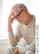 Купить «senior man suffering from headache at home», фото № 24131002, снято 7 июля 2016 г. (c) Syda Productions / Фотобанк Лори