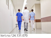 Купить «group of medics or doctors walking along hospital», фото № 24131070, снято 3 декабря 2015 г. (c) Syda Productions / Фотобанк Лори