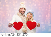 smiling couple in winter clothes with red hearts, фото № 24131270, снято 8 октября 2015 г. (c) Syda Productions / Фотобанк Лори