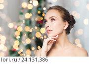Купить «beautiful woman face over christmas lights», фото № 24131386, снято 14 апреля 2016 г. (c) Syda Productions / Фотобанк Лори