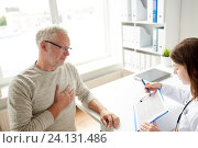 Купить «doctor showing cardiogram to old man at hospital», фото № 24131486, снято 7 июля 2016 г. (c) Syda Productions / Фотобанк Лори