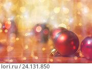 Купить «close up of red christmas balls on wood», фото № 24131850, снято 1 октября 2015 г. (c) Syda Productions / Фотобанк Лори