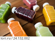 Купить «bottles with different fruit or vegetable juices», фото № 24132002, снято 5 августа 2016 г. (c) Syda Productions / Фотобанк Лори