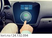 Купить «close up of man using starter application in car», фото № 24132094, снято 17 июля 2015 г. (c) Syda Productions / Фотобанк Лори