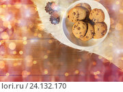 christmas cookies in bowl and cones on fur rug. Стоковое фото, фотограф Syda Productions / Фотобанк Лори