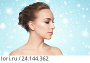 Купить «beautiful young woman face over snow», фото № 24144362, снято 14 апреля 2016 г. (c) Syda Productions / Фотобанк Лори