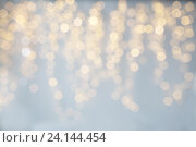 Купить «blurred christmas holidays lights bokeh», фото № 24144454, снято 15 октября 2016 г. (c) Syda Productions / Фотобанк Лори