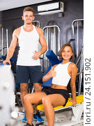 Купить «man and woman fitness coaches in gym», фото № 24151902, снято 4 октября 2016 г. (c) Яков Филимонов / Фотобанк Лори