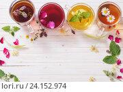 Купить «herbal tea on a white wooden background», фото № 24152974, снято 5 июля 2016 г. (c) Майя Крученкова / Фотобанк Лори