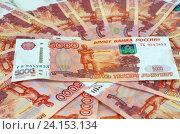 Купить «Российские деньги, пятитысячные купюры», эксклюзивное фото № 24153134, снято 7 октября 2016 г. (c) Елена Коромыслова / Фотобанк Лори