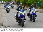 Купить «Эскорт полицейских мотоциклов», фото № 24154294, снято 24 октября 2016 г. (c) AK Imaging / Фотобанк Лори