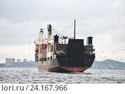 Купить «Cargo ship in harbor logos and brandnames systematically removed», фото № 24167966, снято 1 октября 2016 г. (c) Алексей Суворов / Фотобанк Лори