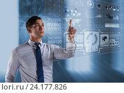 Businessman pressing virtual buttons in futuristic concept. Стоковое фото, фотограф Elnur / Фотобанк Лори