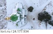 Купить «Вид сверху на заснеженную крышу и купол деревянной церкви, Сегежа, Карелия», видеоролик № 24177934, снято 8 ноября 2016 г. (c) Кекяляйнен Андрей / Фотобанк Лори