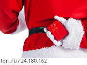Купить «Santa clause holding a gift box behind his back», фото № 24180162, снято 6 сентября 2016 г. (c) Wavebreak Media / Фотобанк Лори