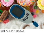Купить «Various types of doughnuts and cupcakes with glucometer», фото № 24180222, снято 12 августа 2016 г. (c) Wavebreak Media / Фотобанк Лори