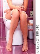 Купить «Woman smoking in a toilet room», фото № 24180310, снято 20 февраля 2019 г. (c) Nobilior / Фотобанк Лори