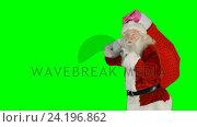 Santa claus carrying gifts in sack. Стоковое видео, агентство Wavebreak Media / Фотобанк Лори