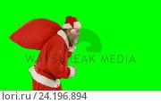 Купить «Santa claus holding sack», видеоролик № 24196894, снято 21 февраля 2019 г. (c) Wavebreak Media / Фотобанк Лори