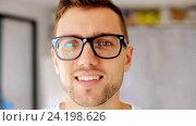 Купить «happy smiling man in eyeglasses», видеоролик № 24198626, снято 6 ноября 2016 г. (c) Syda Productions / Фотобанк Лори