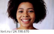 Купить «happy smiling african american young woman face», видеоролик № 24198670, снято 6 ноября 2016 г. (c) Syda Productions / Фотобанк Лори