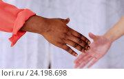 Купить «people of different races handshake», видеоролик № 24198698, снято 6 ноября 2016 г. (c) Syda Productions / Фотобанк Лори