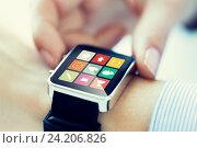 Купить «close up of hands setting smart watch application», фото № 24206826, снято 13 августа 2015 г. (c) Syda Productions / Фотобанк Лори