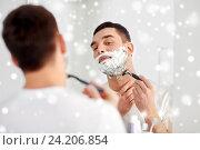 Купить «man shaving beard with razor blade at bathroom», фото № 24206854, снято 15 января 2016 г. (c) Syda Productions / Фотобанк Лори