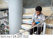 Купить «african student boy or man reading book at library», фото № 24207022, снято 19 июня 2016 г. (c) Syda Productions / Фотобанк Лори