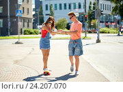 Купить «teenage couple riding skateboards on city street», фото № 24207070, снято 19 июля 2016 г. (c) Syda Productions / Фотобанк Лори