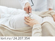 Купить «doctor with stethoscope and pregnant woman», фото № 24207354, снято 20 мая 2016 г. (c) Syda Productions / Фотобанк Лори