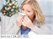 Купить «ill woman blowing nose to paper napkin», фото № 24207802, снято 27 ноября 2015 г. (c) Syda Productions / Фотобанк Лори