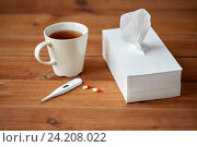 cup of tea, paper wipes and thermometer with pills. Стоковое фото, фотограф Syda Productions / Фотобанк Лори
