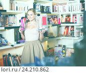 Купить «adult girl choosing toys in sex shop», фото № 24210862, снято 19 февраля 2020 г. (c) Яков Филимонов / Фотобанк Лори