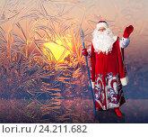 Купить «Santa Claus on the window frosty patterns background», фото № 24211682, снято 5 декабря 2010 г. (c) Владимир Мельников / Фотобанк Лори