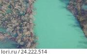Купить «Вид с воздуха на реку Морача, которая впадает в большое Скадарское озеро», видеоролик № 24222514, снято 21 февраля 2016 г. (c) Иван Кузнецов / Фотобанк Лори