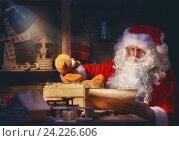 Купить «Santa Clause is preparing gifts», фото № 24226606, снято 8 ноября 2016 г. (c) Константин Юганов / Фотобанк Лори