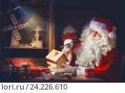Купить «Santa Clause is preparing gifts», фото № 24226610, снято 8 ноября 2016 г. (c) Константин Юганов / Фотобанк Лори