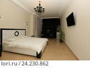 Купить «Интерьер современной спальни», эксклюзивное фото № 24230862, снято 16 октября 2016 г. (c) Яна Королёва / Фотобанк Лори