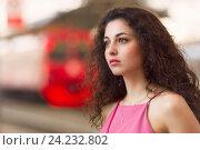 Купить «Девушка и уходящая электричка на вокзале», фото № 24232802, снято 3 июля 2016 г. (c) Алексей Назаров / Фотобанк Лори