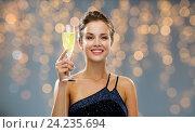 Купить «smiling woman holding glass of sparkling wine», фото № 24235694, снято 1 июня 2014 г. (c) Syda Productions / Фотобанк Лори